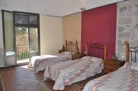 family room with a double bed and 3 single beds
