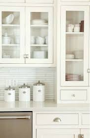 Exceptional Source: Ashlee Raubach Photography Lovely Kitchen Design With White Linear  Glass Tiles Backspalsh, White Shaker Glass Front Kitchen Cabinets, ... Gallery
