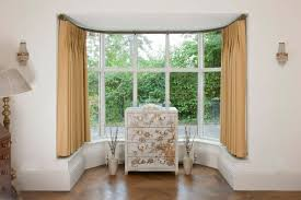 beautiful of hang net curtains bay window centerfordemocracy ideas