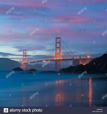 Blue Light In San Francisco Sky Golden Gate Bridge Seen From Baker Beach In Beautiful Golden