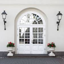 white front door with paneling and lots of gl