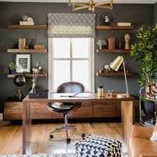 trendy home office design. Example Of A Trendy Freestanding Desk Medium Tone Wood Floor And Brown Study Room Design Home Office O