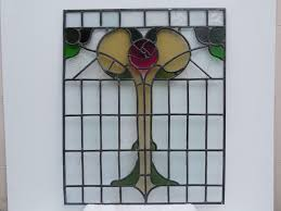 after door panel removed and repaired with original stained glass materials
