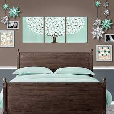 bed setting view of large wall art sea glass and brown tree on extra large wall art teal with canvas wall art tree painting triptych in teal brown large amborela