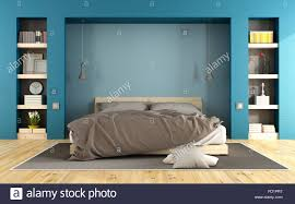 Blue Modern Bedroom With Wooden Bed And Niche With Books   3D Rendering    Stock Image