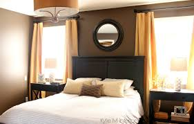dark bedroom paint colour benjamin moore brown horse with gold and yellow accents dark wood headboard and side tables with lamps