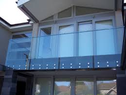 SimplyFrameless Exterior Bolt Fixed Balustrade with Handrail through the  glass
