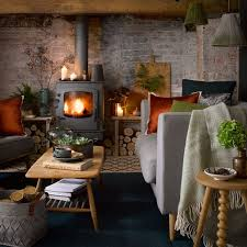 country cabin living room with woodburning stove and cosy knits