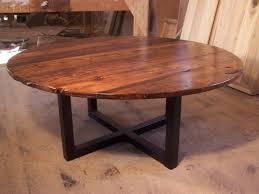 large round coffee table with industrial metal base
