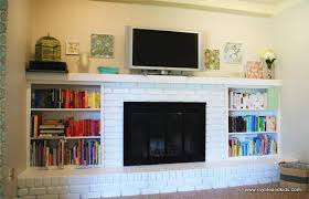 this painted brick fireplace looks great with the built in bookshelves