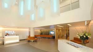 commercial foyer office interior lighting design linear pendants nulty