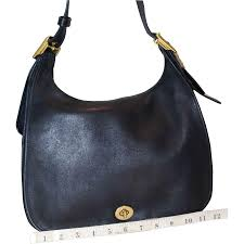 This beautiful handbag is the original Coach Legacy Flap Model 9718 Large  Edition in the rare