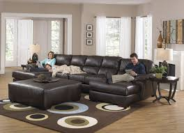 best leather sectional with chaise and recliner large ottoman coffee table set on bubble pattern rug