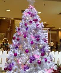 This tree reminds me of my mom's Christmas trees. White with purple  ornaments.