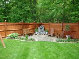unique patio ideas on a budget with corner fire pit and wooden back yard for small