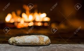 Freshly Baked Bread In Rustic Bakery With Traditional Stone Oven