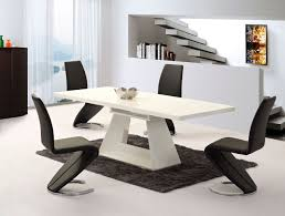 extending white high gloss dining table and  black chairs