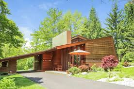 a rustic frank lloyd wright fits like a glove in its landscape