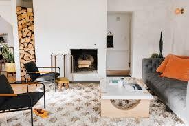Living room interior design with fireplace Different Style Chris And Claude Put Stucco On Top Of The Fireplaces Outdated Stone The Living Rooms Dwell Best Modern Living Room Wood Burning Fireplace Design Photos And