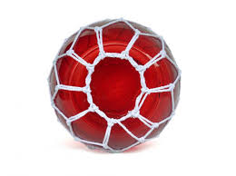 red japanese glass fishing float bowl with decorative white fish netting 10
