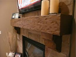 a decorative mantel completes this fireplace makeover project