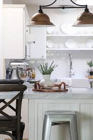 Gorgeous white kitchen with copper accents and marble countertops (tile!)
