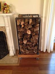 fireplace wood rack recycled pallets and some black pipe