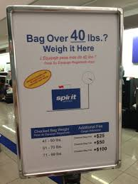 a sign at bwi shows spirit airlines checked bag rules
