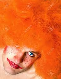 red haired angry man with a clown make up looking up inspired by stephen