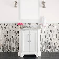 black and white bath with a white vanity