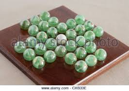 Wooden Solitaire Game With Marbles glass marble solitaire game on wooden board Stock Photo Royalty 82