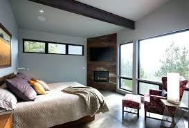 above bed mount corner fireplace ideas bedroom contemporary with framed artwork mounted over tv under motorized