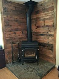 replace wood stove with gas fireplace pallet wall behind wood stove replace wood stove with gas