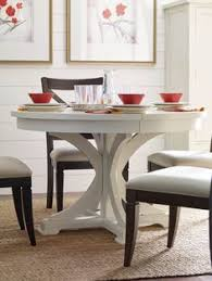 rachael ray home everyday dining collection pedestal table in sea salt with chairs in