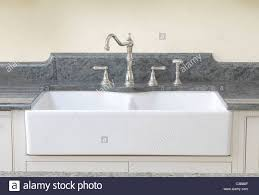 ceramic farmhouse sink. Brilliant Ceramic Double French Farmhouse Sink With The Ceramic Front Exposed And Set Under A  Granite Worktop Inside Ceramic Farmhouse Sink N