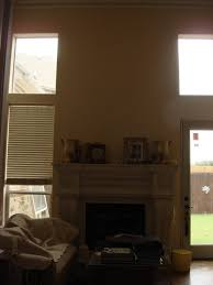 hanging large mirror over mantle on