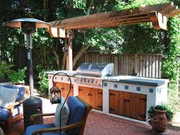 Complete Outdoor Kitchen A Wooden Pergola Shades This Southwestern Style Outdoor Kitchen