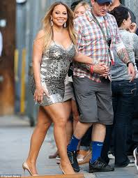 taking a walk on the wild side mariah carey turned heads as she arrived at