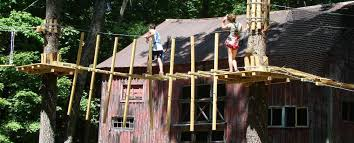 kids tree houses with zip line. Perfect Zip A Young Lady Watches Her Male Friend Cross The Obstacle Bridge With Kids Tree Houses Zip Line