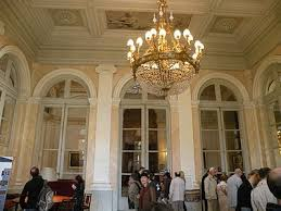the salon abel de pujol with neoclassic grisaille paintings of famous french rulers on the ceiling