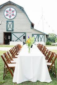 al fresco dining at wedding reception in front of barn