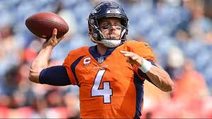 quarterback case keenum 4 of the denver broncos throws as he warms up before a game against the oakland raiders at broncos stadium at mile high on