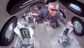 Richard Branson rockets into space ...