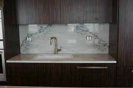 light color quartz countertops kitchen sink with backsplash with dark cabinets