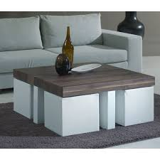 Coffee table with stools -- love this idea for stools tucked under a coffee  table