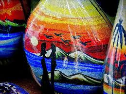 sand painting behind glass