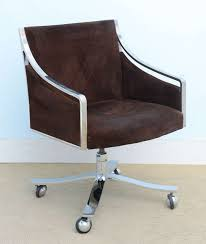 stow and davis mid century modern swivel chair with dark coffee upholstery and silver curved arms and wheels on metal base