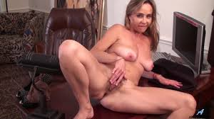 Betsy Long fingering that hairy pussy of hers PornDoe