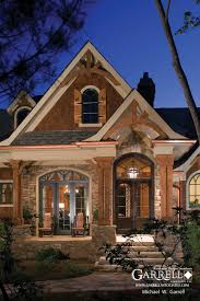 french country house with large front porch monet manor plan plans by garrell associates inc a