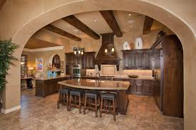 tuscan kitchen lighting. Charming Tuscan Kitchen Interior Design With A Marble Topped Island Bar Stools And Pendant Lighting Hung At Exposed Beams Ceiling E